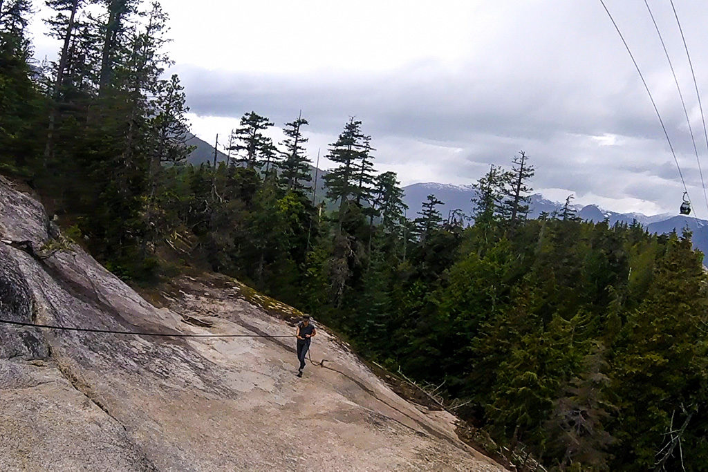 Hiker using rope assist along the Sea to Summit Trail near Squamish, BC