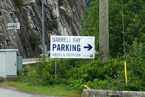 Sign indicating the Darrell Bay parking area for the Sea to Summit Trail near Squamish, BC