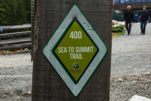 A green diamond trail marker along the Sea to Summit Trail